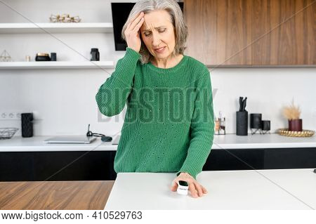 Senior Mature Lady Suffering From Strong Chronic Headache Migraine, Feeling Dizzy, Struggling From P