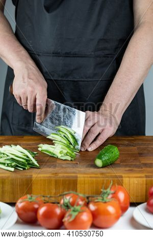 Close Up Of Chef Cook Hands Chopping Vegetables For Traditional Asian Cuisine With Japanese Knife. P