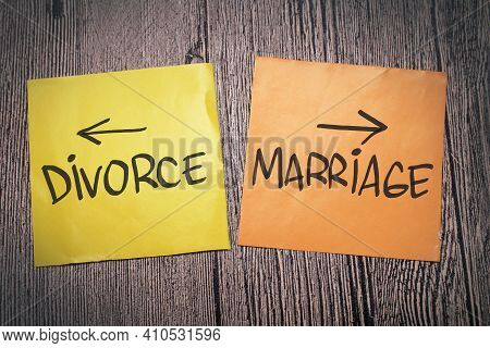 Divorce Or Marriage, Text Words Typography Written On Paper Against Wooden Background, Life And Busi