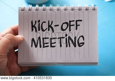 Kick-off Meeting, Text Words Typography Written On Paper Against On Blue Background, Life And Busine