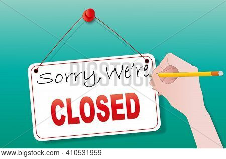 Sorry, We're Closed, A Hand With A Pencil Is Writing On A Sign On The Store Door. Close Up Time Back