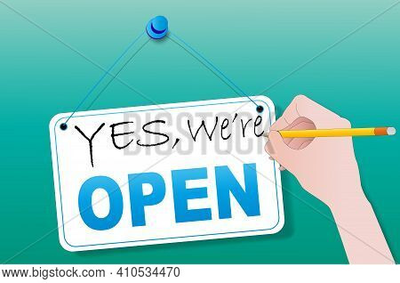 Yes, We Are Open, A Hand With A Pencil Writes On A Sign On The Door Of The Store. Business Concept A