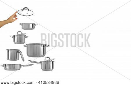 Stainless Steel Pots,saucepans,frying Pan,ladle In Shape Of Pyramid Or New Year Tree,hand Holding Tr