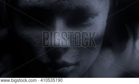 Antique Stone Female Head Sculpture Isolated On Black Background. Ancient Sculpture. Close-up, Depth
