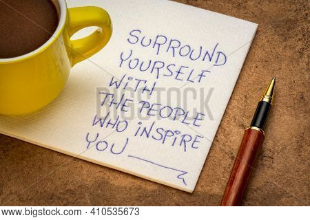 surround yourself with the people who inspire you - inspirational handwriting on a napkin with a cup of coffee,education and personal development concept