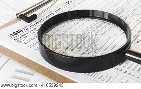Tax Forms Investigation Concept With Magnifying Glass And 1040 Us Income Tax Return