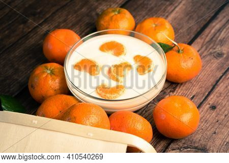 Homemade Clementine Yogurt With Fresh Tangerines In A Glass Bowl On A Wooden Table