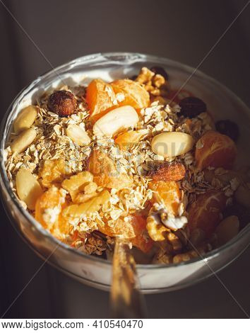 A Bowl Of Granola Cereal With Fresh Fruit And Yogurt. Breakfast Cereal With Nuts, Oatmeal And Fruit.
