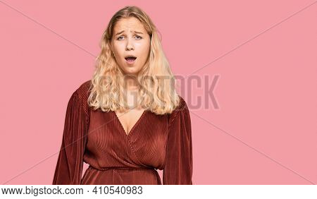 Young blonde girl wearing casual clothes scared and amazed with open mouth for surprise, disbelief face
