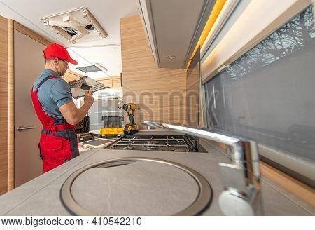 Recreational Vehicle Rv Camper Appliances Caucasian Technician In His 40s Repair Air Condition Unit