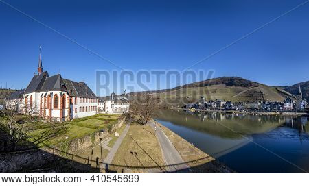 Skyline Of Bernkastel-kues With River Mosel And Cusanus Stift In Foreground