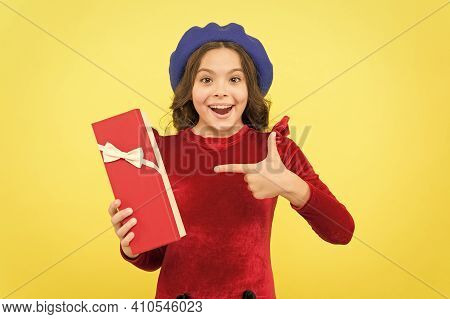 Look At That. Successful Shopping Time. Happy Childhood. Smiling French Teen Girl In Beret Pointing