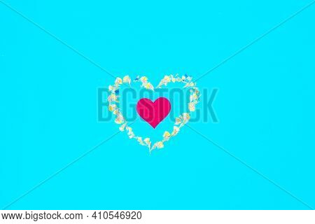 Heart Of Yellow Dried Flowers On A Blue Monochrome Background, A Symbol Of Lov