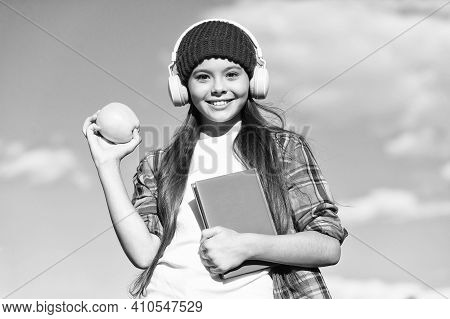 Natural Alternative To Dieting. Happy Girl Hold Apple On Blue Sky. Fruit Snack. Healthy Eating Habit