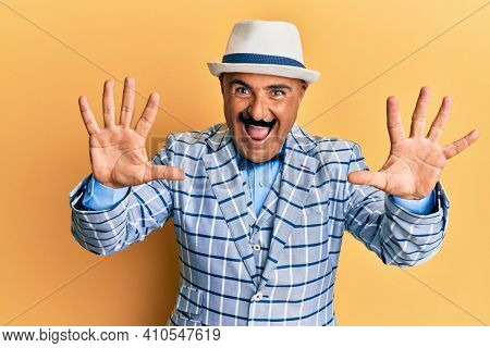 Mature middle east man with mustache wearing vintage and elegant fashion style showing and pointing up with fingers number ten while smiling confident and happy.