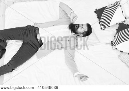 Dozes Off For A Time. Bachelor Stretch And Yawn After Sleep. Bearded Man In Formal Wear Lying In Bed