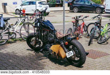 Strasbourg, France - Jun 18, 2018: City Public Parking With Black Harley Davidson Sportster Motorcyc