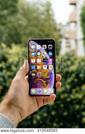 Paris, France - Oct 2, 2018: Pov Male Hand Holding New Latest Apple Computers Iphone 11 12 Pro With