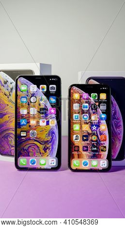 Paris, France- Oct 2, 2018: Unboxing From The Cardboards Of Two Latest Apple Computers Iphone Smartp