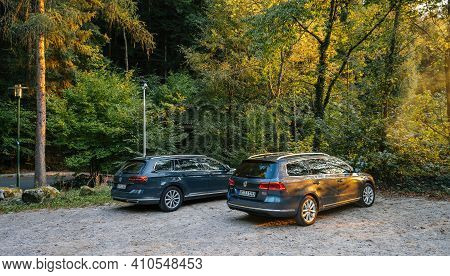 Germany - Oct 7, 2018: Rear View Of Two Volkswagen Passat Electric Cars Parked In German Outdoor Par