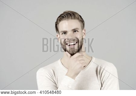 Happy Man Touch Beard On Unshaven Face, Barber. Macho Smile With Stylish Hair, Haircut, Grooming. Ba
