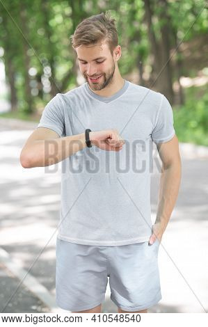 Best For Training. Sportsman Tracking His Training With A Sports Watch. Handsome Athlete Using Smart