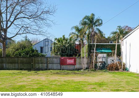 New Orleans, La - February 23: Impeach Trump Sign Displayed In Front Of Wooden Fence On Empty Lot On