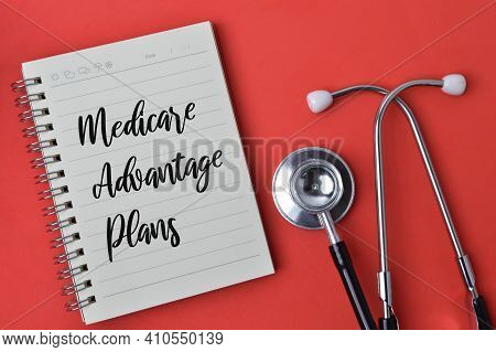Stethoscope And Notebook Written With Text Medicare Advantage Plans.