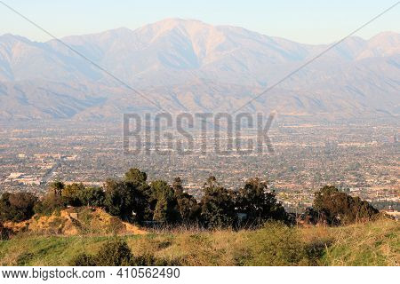 Rugged San Gabriel Mountains Including Mt Baldy Surrounded By The Urban Los Angeles Area Taken At A