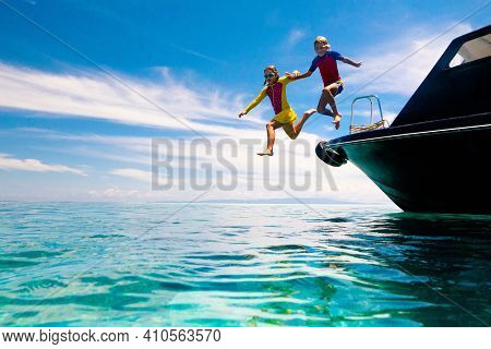 Kids Jump Into Sea. Yacht Vacation With Child On Exotic Tropical Island With Crystal Clear Water. Be