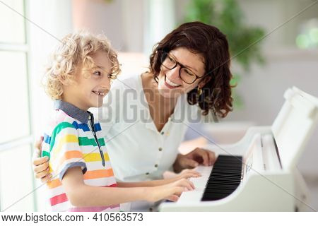 Child Playing Piano. Kids Play Music. Classical Education For Children. Art Lesson. Little Boy At Wh