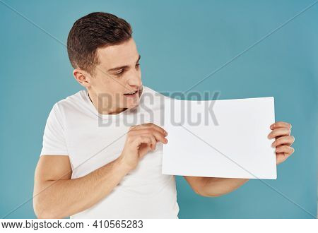 Guy With A White Sheet Of Paper Blue Background Advertising Mocap Poster