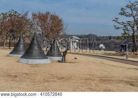 Chungju, South Korea; Feb. 24, 2021: Sculpture Of Young Deer In Front Of Pagodas At Jungang-tap Hist