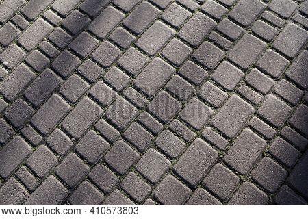 Texture Of Stone Paving Stones. Cobblestone Diagonal Pavement Road At Sidewalk. Hard Surface. Stone