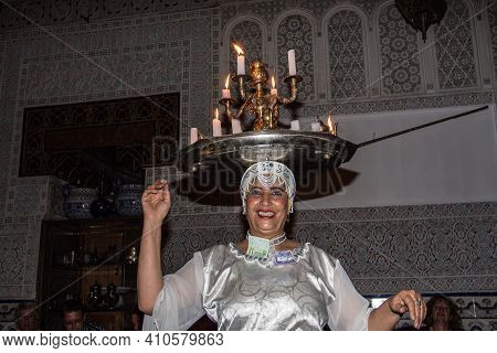 Marrakesh, Morocco - Oct 22, 2019: A Female Artist Dancing To Traditional Folk Music In A Restaurant