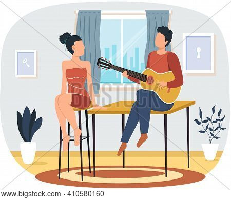 Man Sings Song To Girlfriend. Couple In Relationship At Home Enjoying Time With Guitar. Guy Plays Mu