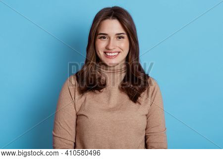 Close Up Portrait Of Beautiful Young European Woman Model With Dark Hair Looking At Camera With Char