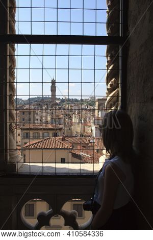 Firenze, Italy - April 21, 2017: A Girl Look Florence City Center From A Window, Firenze, Tuscany, I