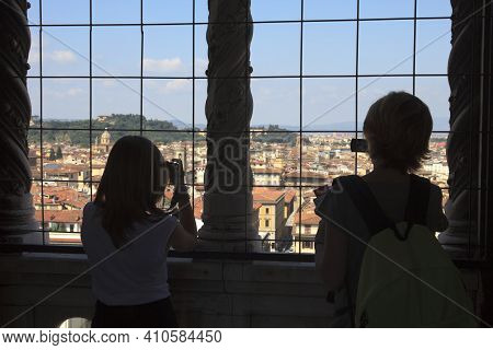 Firenze, Italy - April 21, 2017: Tourist Take A Picture Of Florence City Center From A Window, Firen