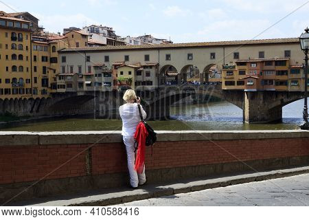 Firenze, Italy - April 21, 2017: Tourist Taking A Picture Of The Ponte Vecchio, Florence, Firenze, T