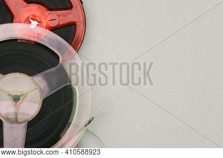 Roll Of Film On A Green Background. Magnetic Tape Reels. Old Films On Film. Retro Style. Analog Tech