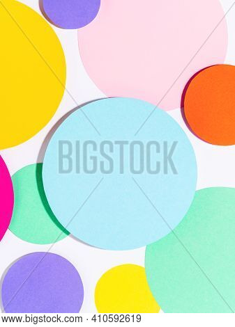 Background Of Colorful Paper Circles In Memphis Geometric Style. Cut Out Circles Styled Layout With