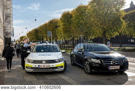 Copenhagen, Denmark - Oct 19, 2018: Police Officers Looking Towards Camera, Standing Beside Their Ve