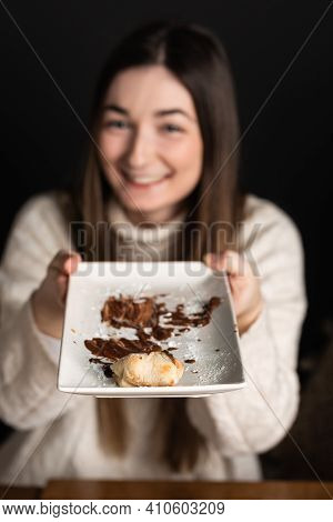 Girl Offers A Plate The Last Piece Of Chocolate Cream Pizza Dessert.