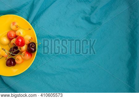 Sweet Cherry In A Yellow Plate. Fresh Fruits.