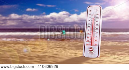 Thermometer In The Sand, Blue Sky Background, Temperature Forty Degrees Celcius. 3D Illustration