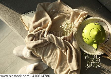 Soft Cashmere Sweater, Tea Pot And Flowers On Sofa, Flat Lay