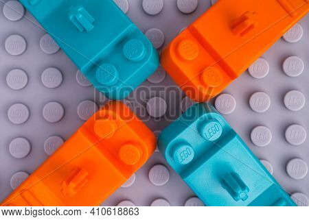 Tambov, Russian Federation - January 17, 2021 Four Lego Teal And Orange Brick Separators On Gray Bas