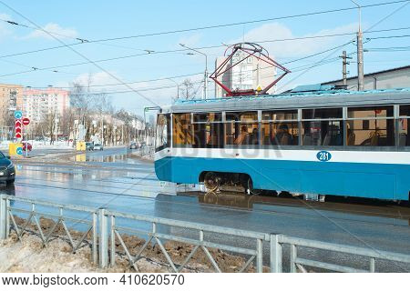 Blue Old Tram At The City Crossroads During The Day. Sunny Spring Day, Thaw. Smolensk, Russia 03.01.