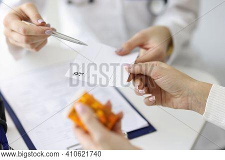 Doctor Giving Patient Paper Prescription For Medicine Closeup. Prescription And Nonprescription Drug